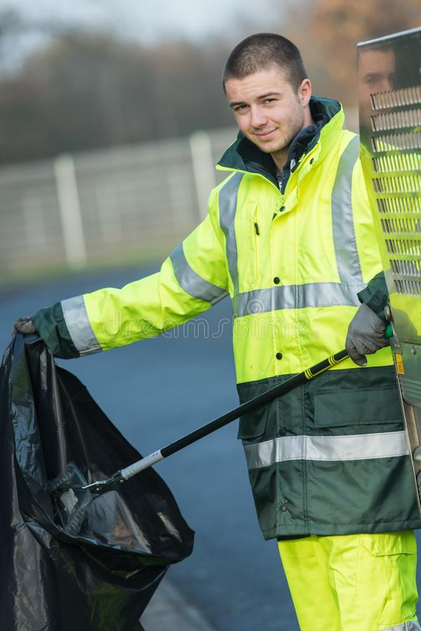 Young waste collector at work royalty free stock image