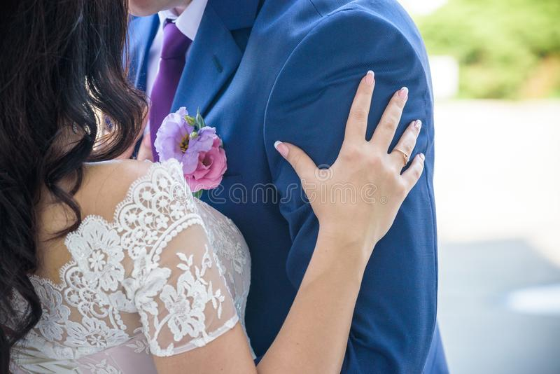 Young wedding couple enjoying romantic moments outside on a summer meadow royalty free stock images