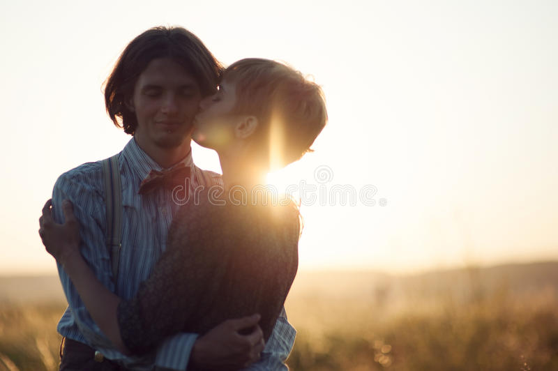 Young wedding couple enjoying romantic moments outside on a summ stock photos