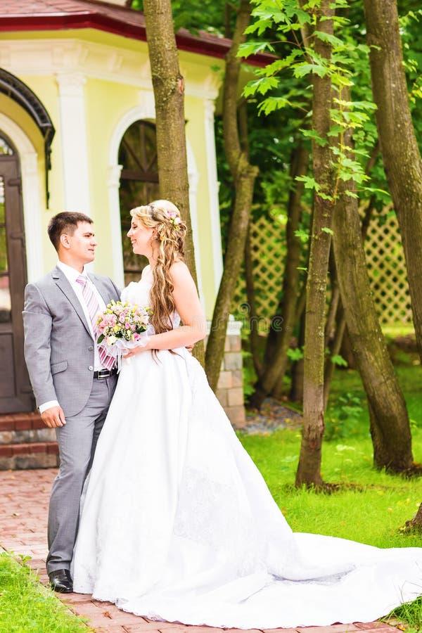 Young wedding couple enjoying romantic moments stock photography