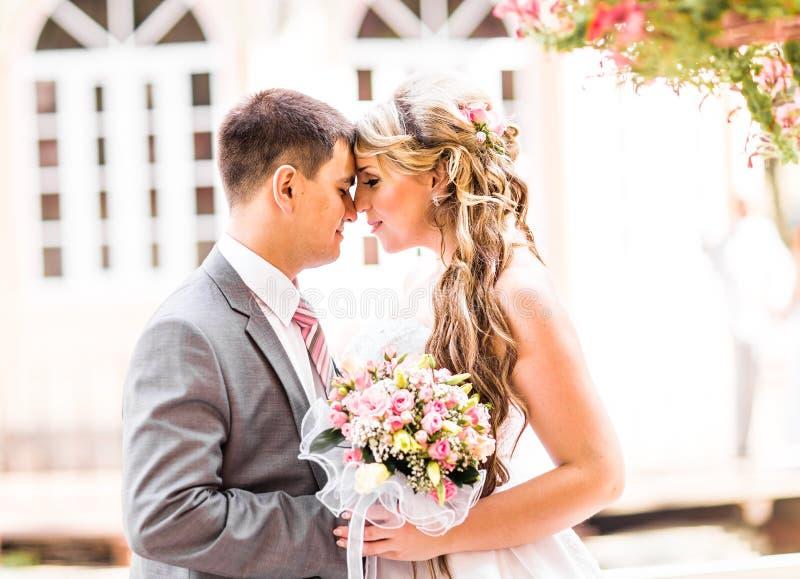 Young wedding couple enjoying romantic moments stock photos
