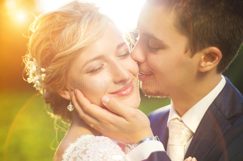 Young wedding couple on summer meadow stock photos