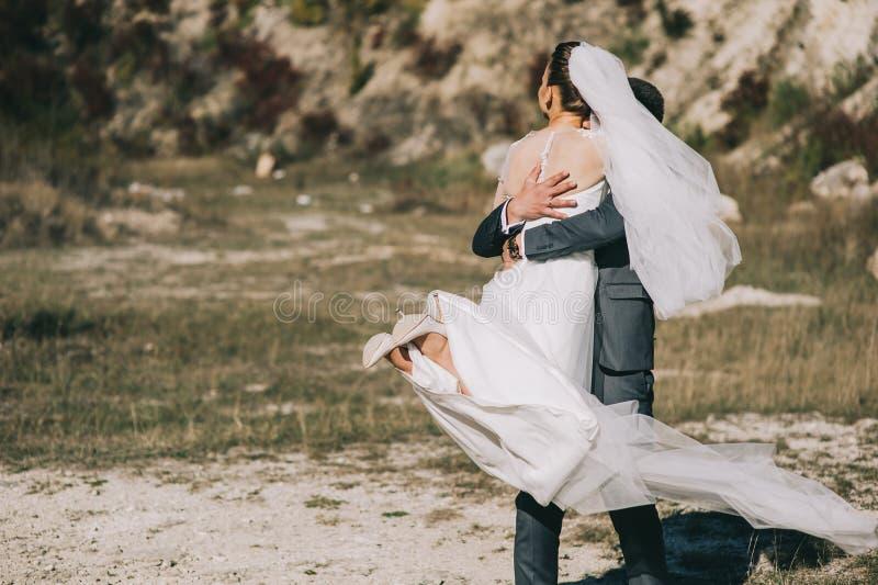 Young wedding couple walking royalty free stock image