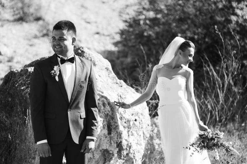Young wedding couple walking stock photos