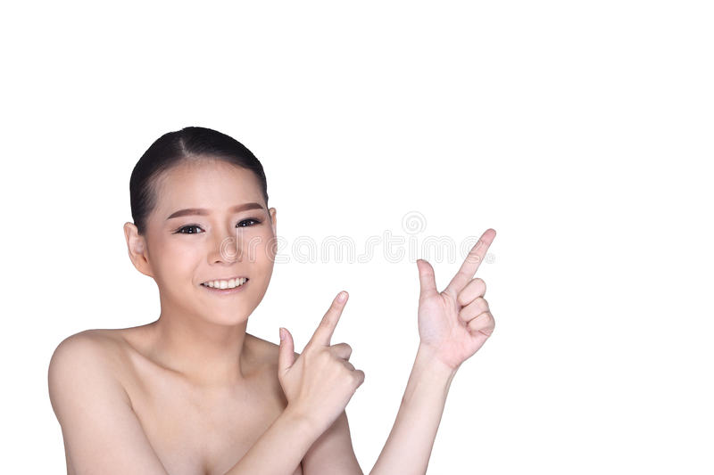 Young White Asian woman fahion make up showing empty copy space stock photography