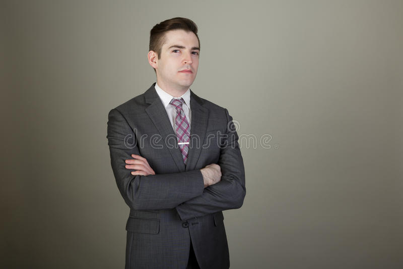 Young White Business Man in a suite with arms folded. stock images