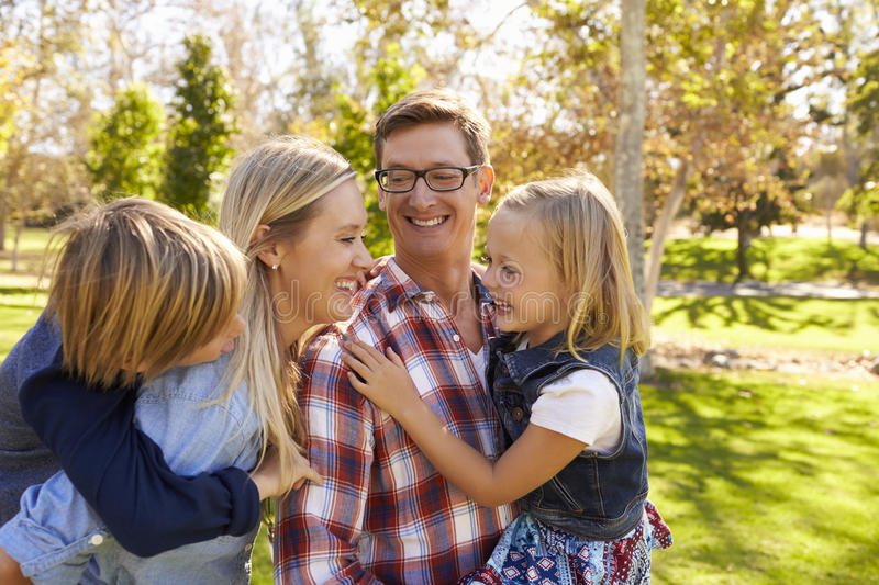 Young white family having fun together in a park royalty free stock photos