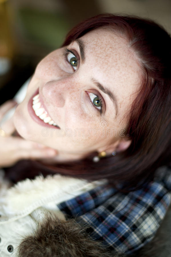 Young White Girl with Green Eyes Smiling royalty free stock photography