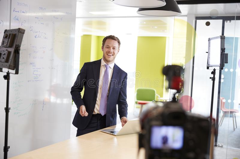 Young white man making a corporate demonstration video stock image