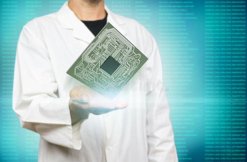 Young white scientist holding computer microchip on a modern blue virtual screen interface background royalty free stock photos