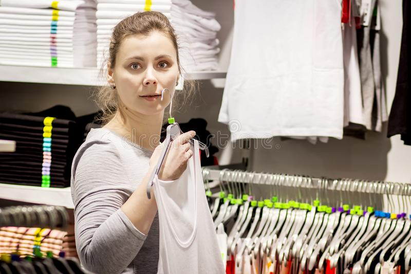 Young white woman in stylish clothes shop royalty free stock image