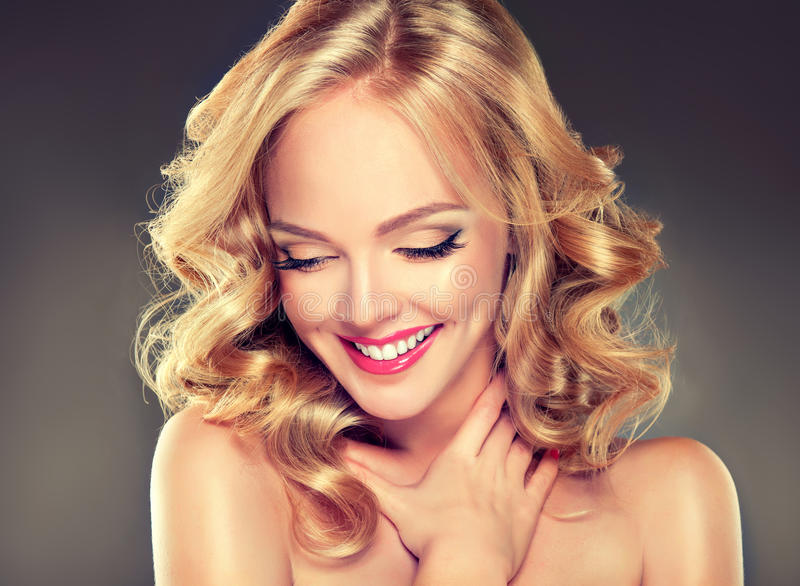 Young wide smiling blonde haired girl-model. stock photo