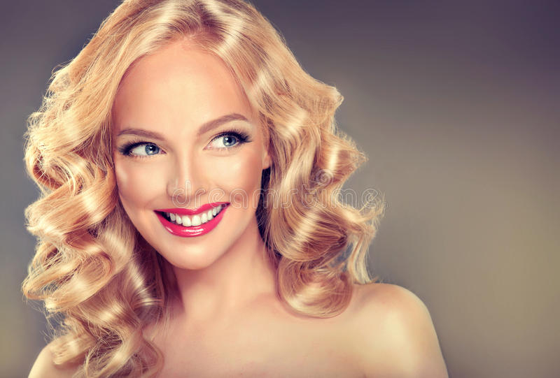 Young wide smiling blonde model. stock photography