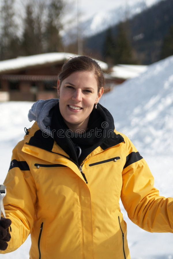 Young winter beauty. A young woman outdoor in a winter setting. The active woman is about to go crosscountry skiing stock photography
