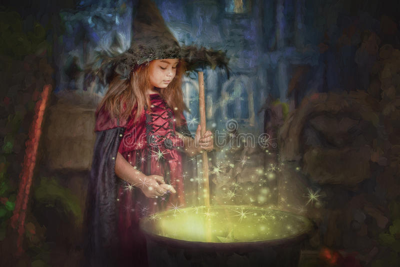 Young witch stirring cauldron stock photos
