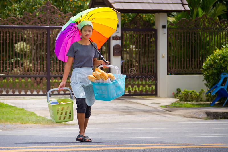 Download Young Womaan Carying Fresh Bread To The Local Market Editorial Photo - Image: 28272616
