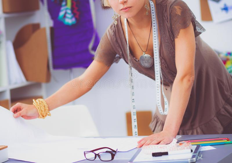 Young woman fashion designer working at studio. royalty free stock image
