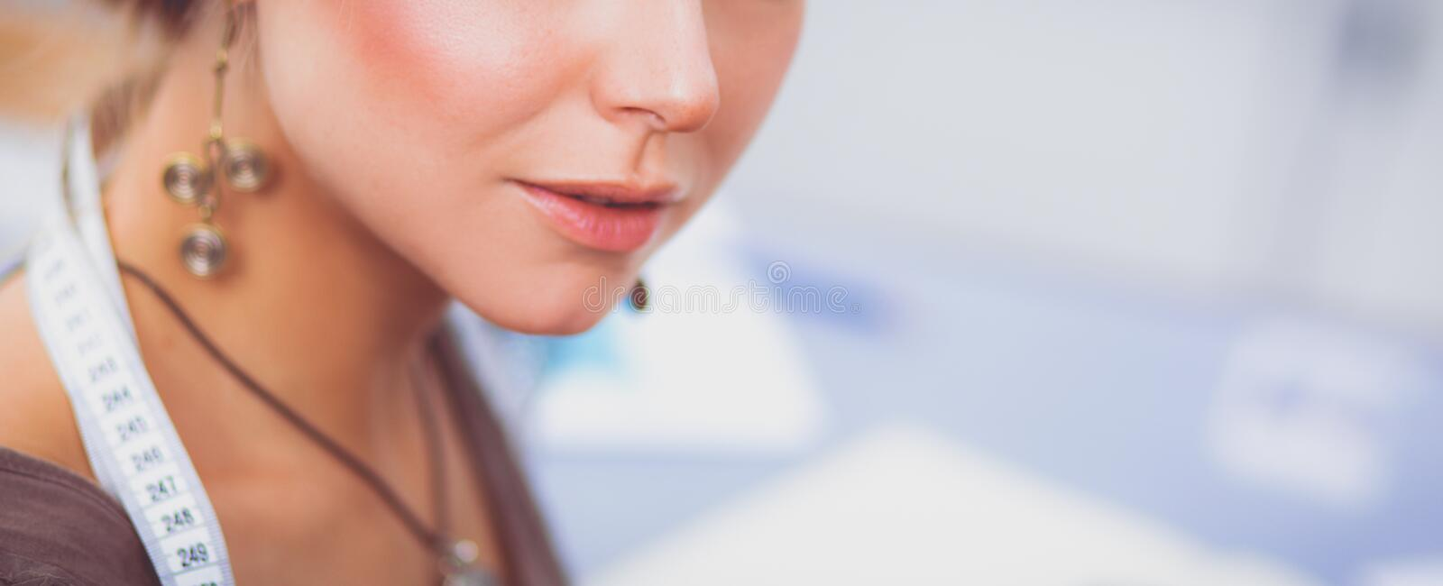 Young woman fashion designer working at studio. royalty free stock photos