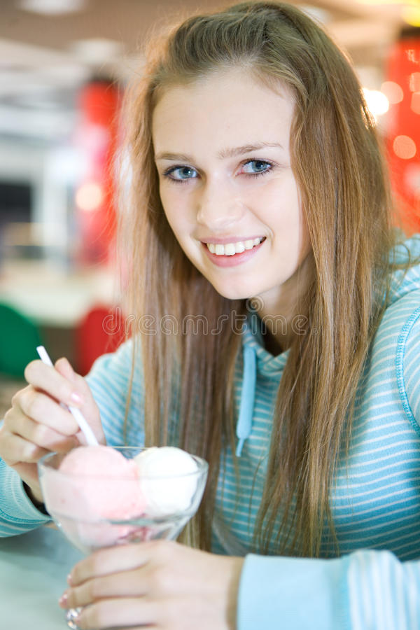 Young woman. With ice cream stock photography