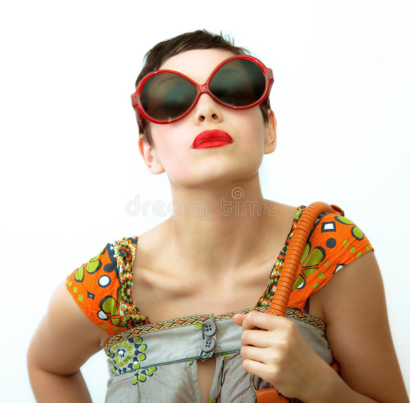 Young woman. With sunglasses and bag over white background stock photos