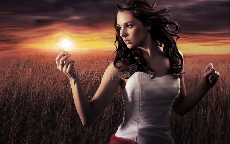 Young woman. Woman holding a light bulb