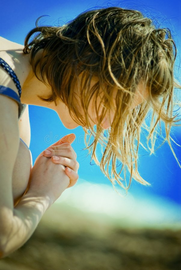 Young Woman. A young woman playing at the beach on a beautiful morning royalty free stock images