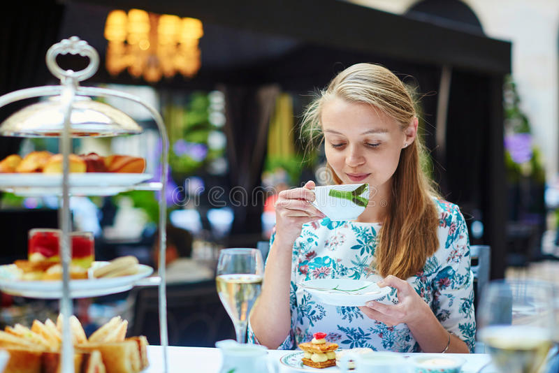 Young woman at the afternoon tea ceremony stock images