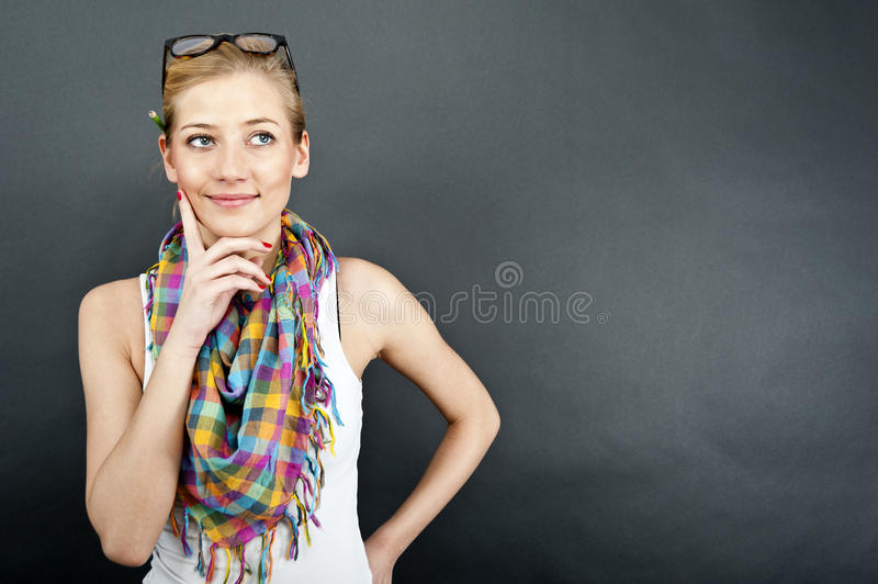 Young Woman Against The Black Background Stock Photo