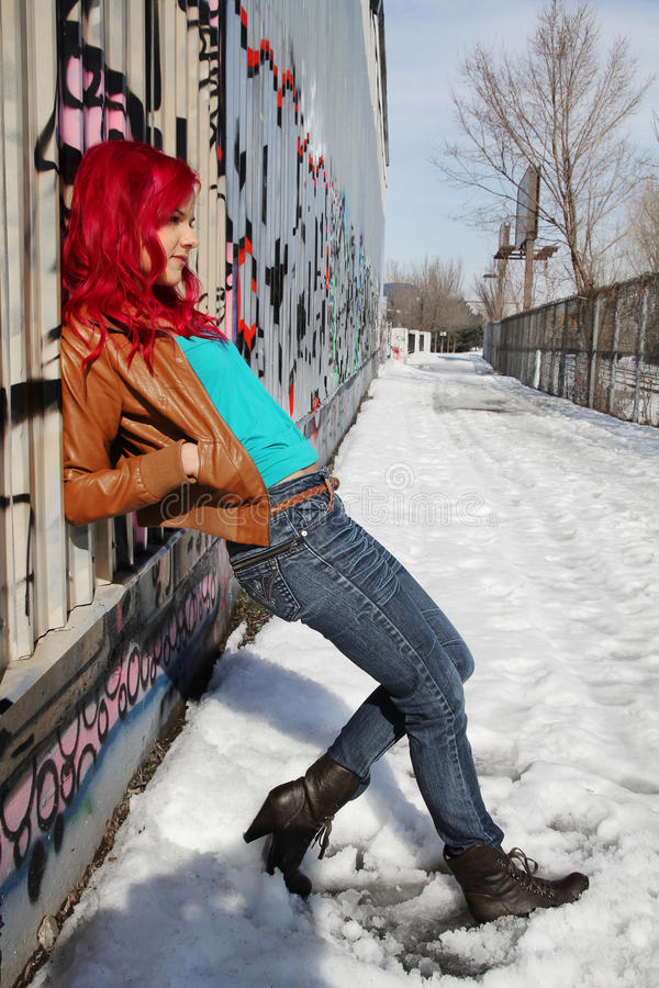 Young woman against a wall royalty free stock image