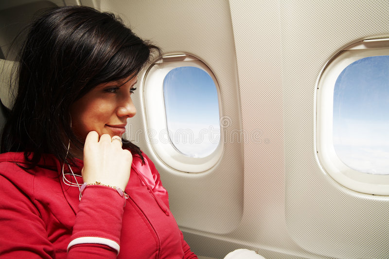 Young woman at airplane royalty free stock photo