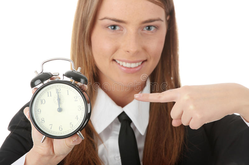 A young woman with alarm clock. Isolated royalty free stock photo
