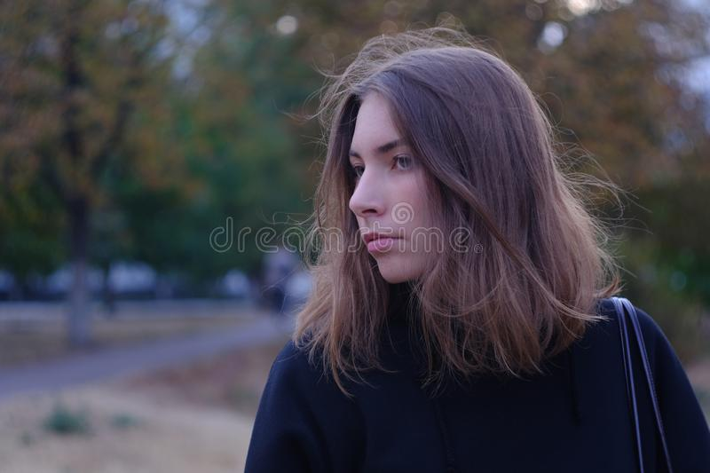 Young woman alone in autumn city street royalty free stock images