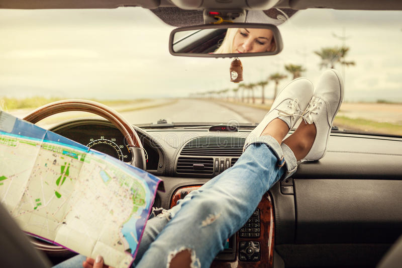 Young woman alone car traveler with map royalty free stock photo