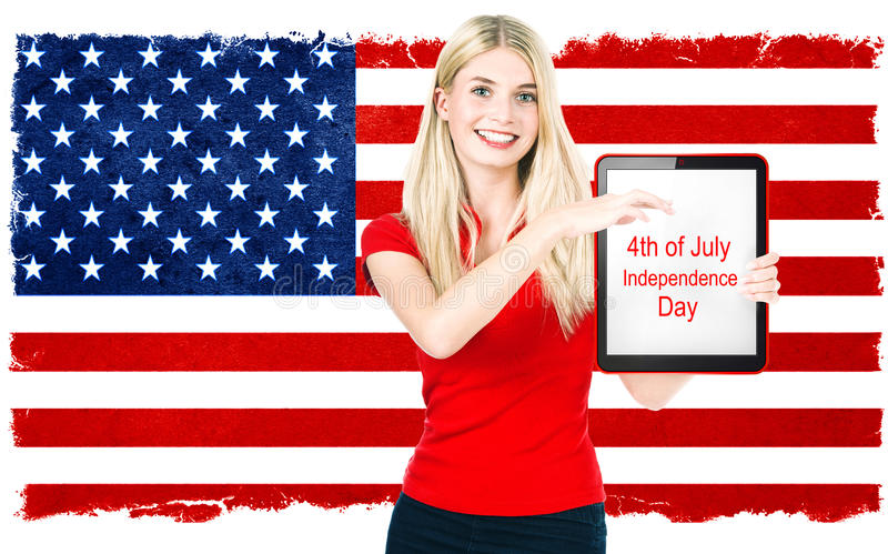 Young woman with american national flag stock photography