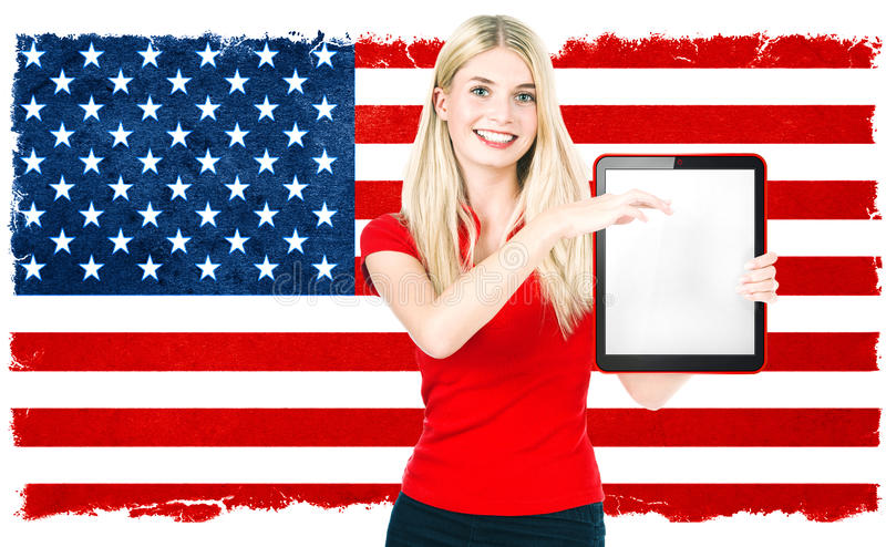 Young woman american national flag US Election results. Young woman with american national flag on the background holding tablet pc. US Election results stock photo