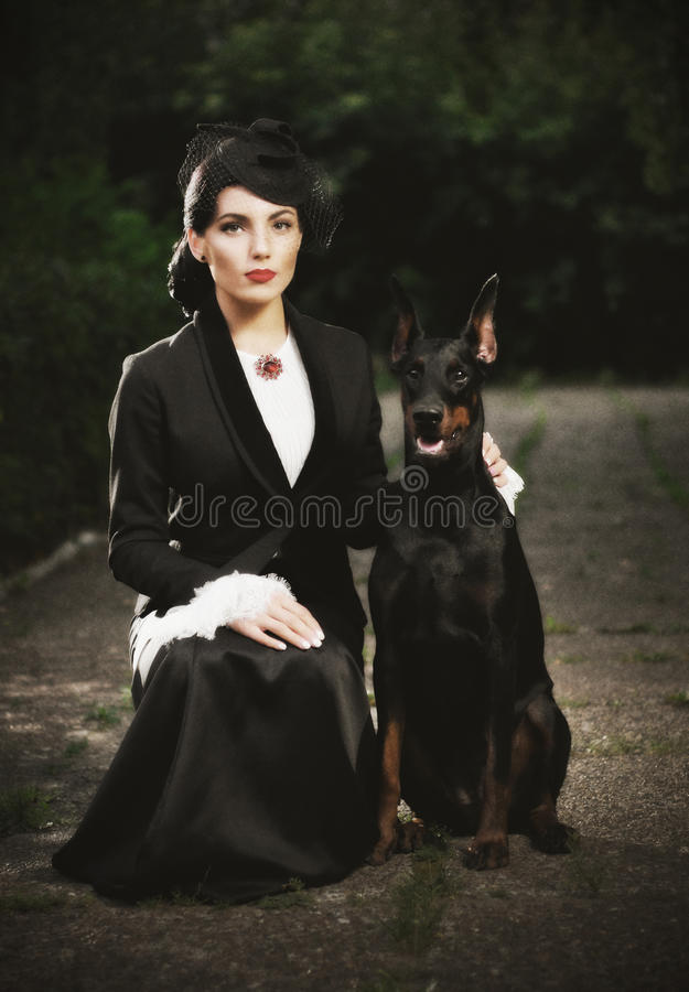 Young woman in ancient costume with dog (ancient ver) stock photography