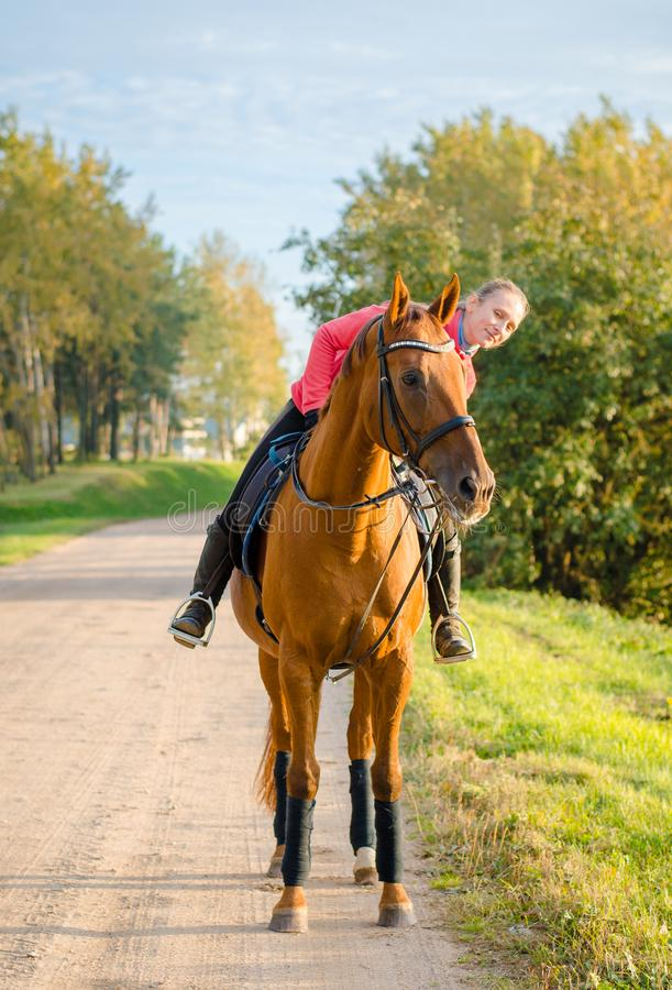 Free Young Woman And Dressage Horse On The Road Stock Photography - 160732592