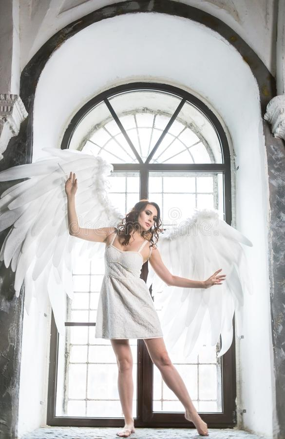 Young woman in angel costume stock images