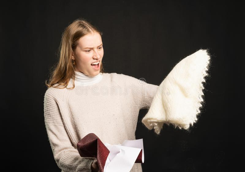 Young woman is angry about her present stock images