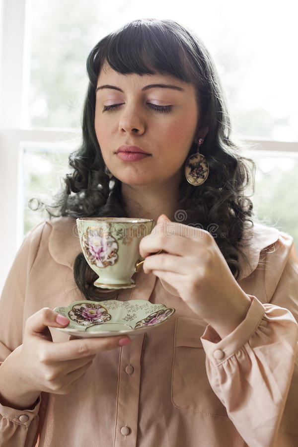 Young Woman with Antique Tea Cup royalty free stock photos