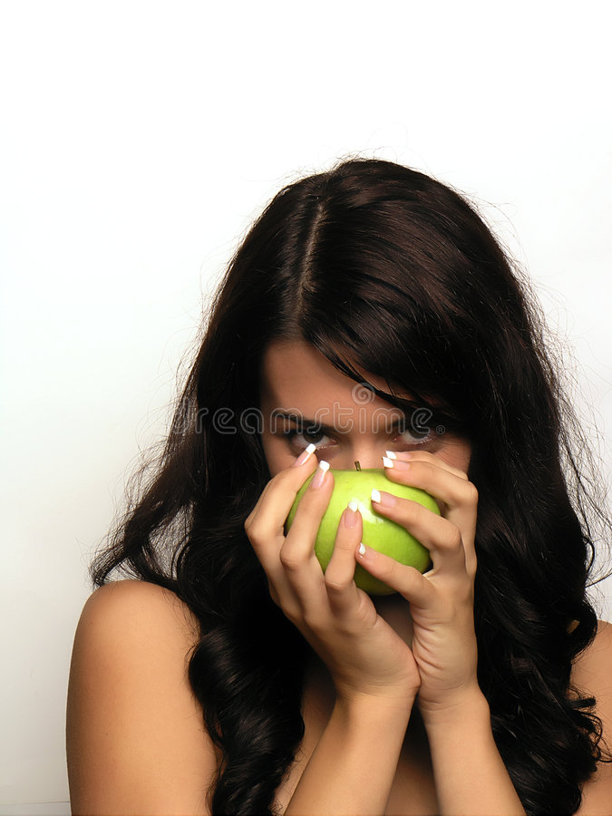 Young woman and apple stock photography