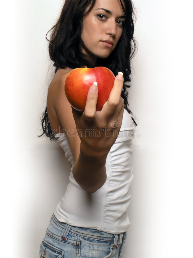 Young woman and apple royalty free stock photos