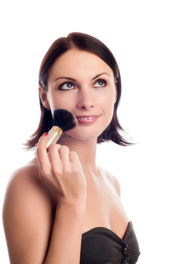 Young woman applying blusher royalty free stock images