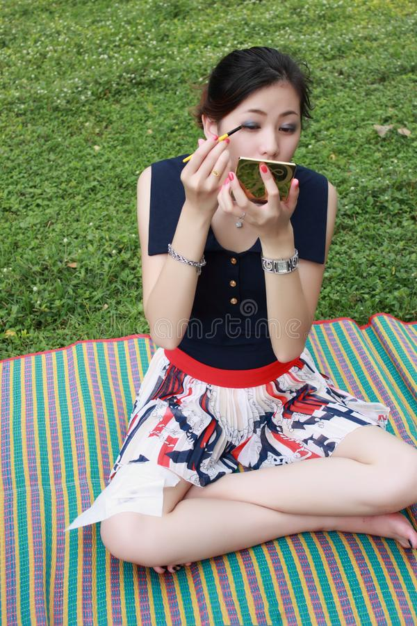 Download Young Woman Applying Mascara Stock Image - Image of dessert, green: 16511729