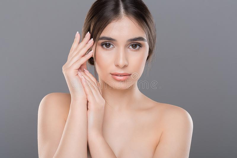 Young woman applying moisturizing cream to her hands skin. Close up stock image
