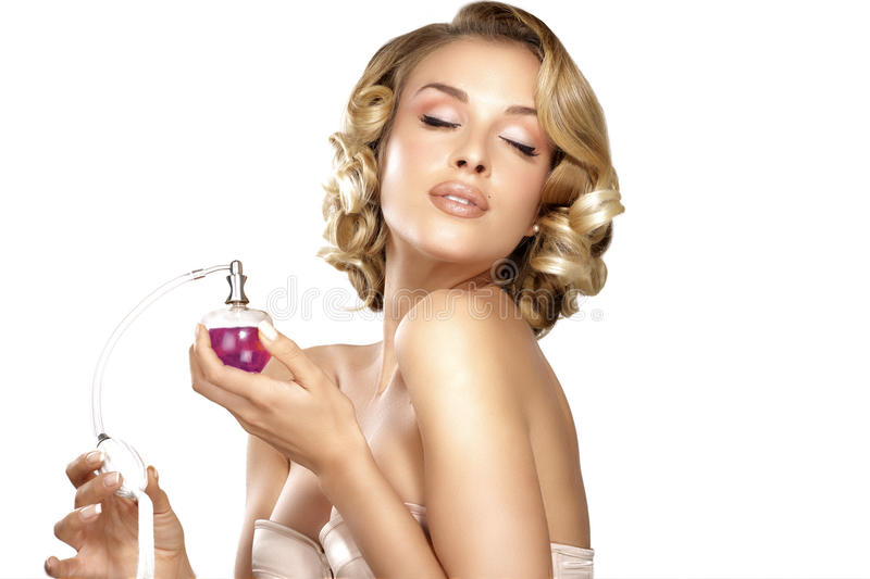 Young woman applying perfume on her neck space for text stock image