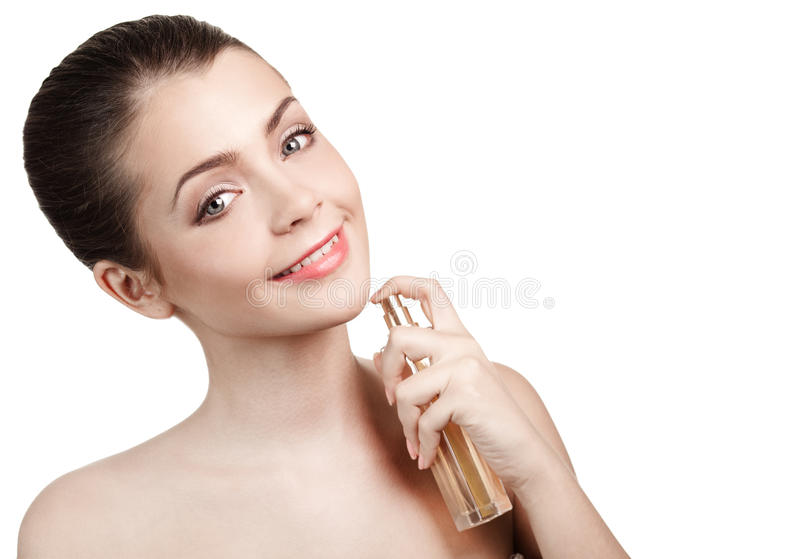 Young Woman Applying Perfume On Herself Stock Images