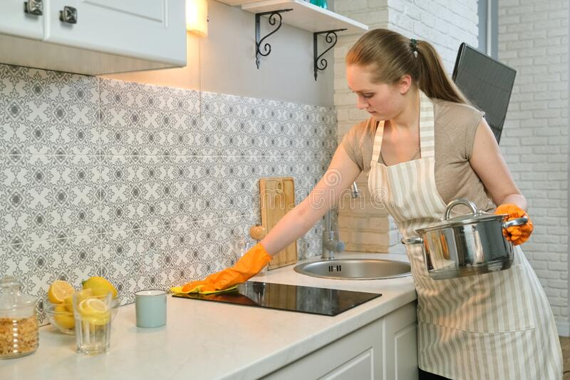 Beautiful Cooking Woman In Apron And Kitchen Glove Stock ...
