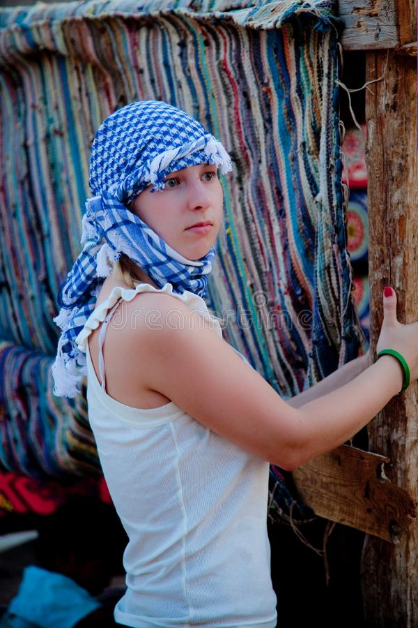 Young woman in arabian desert royalty free stock photography