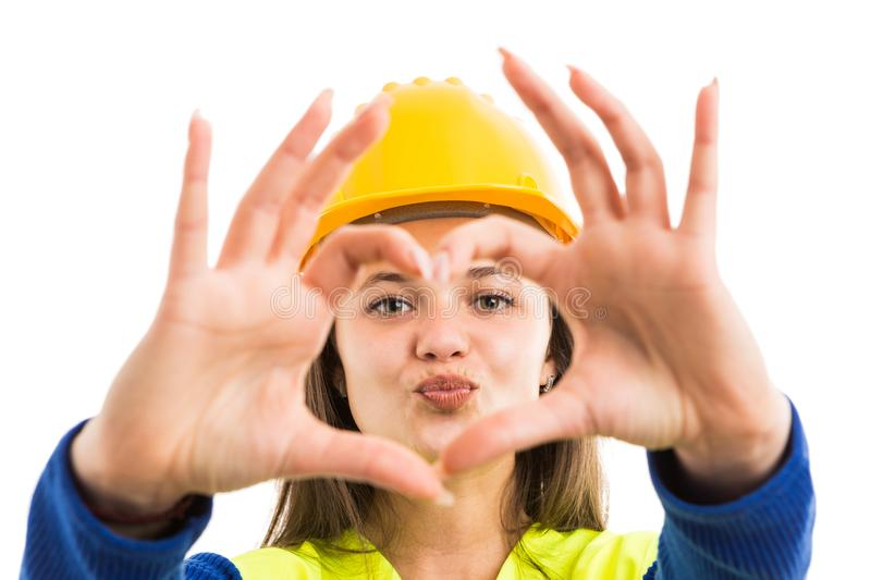Young woman architect showing heart sign stock images